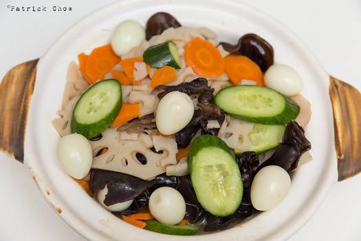 Stir fried vegetables with quail eggs