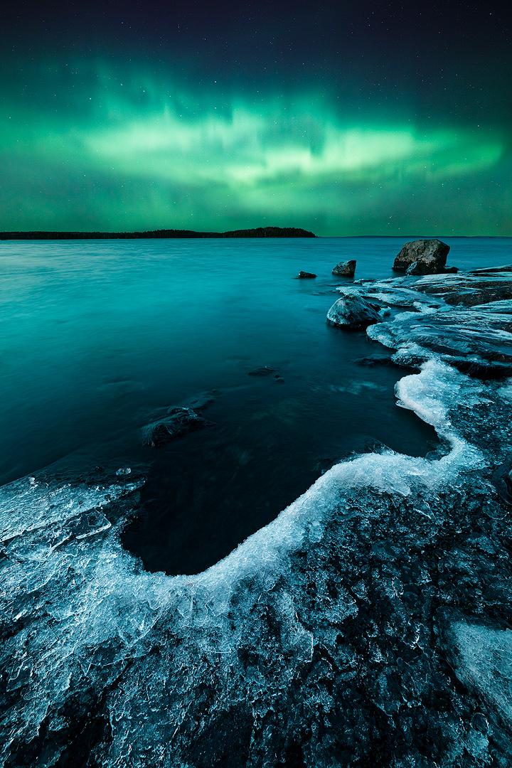 Northern lights lake by JuhaniViitanen