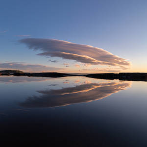 Lenticular clouds reflection