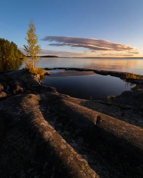 Natural rock pool in lakeshore at dawn