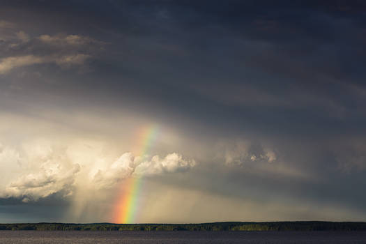Rainbow and storm clouds