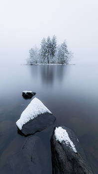 Island at the frozen lake