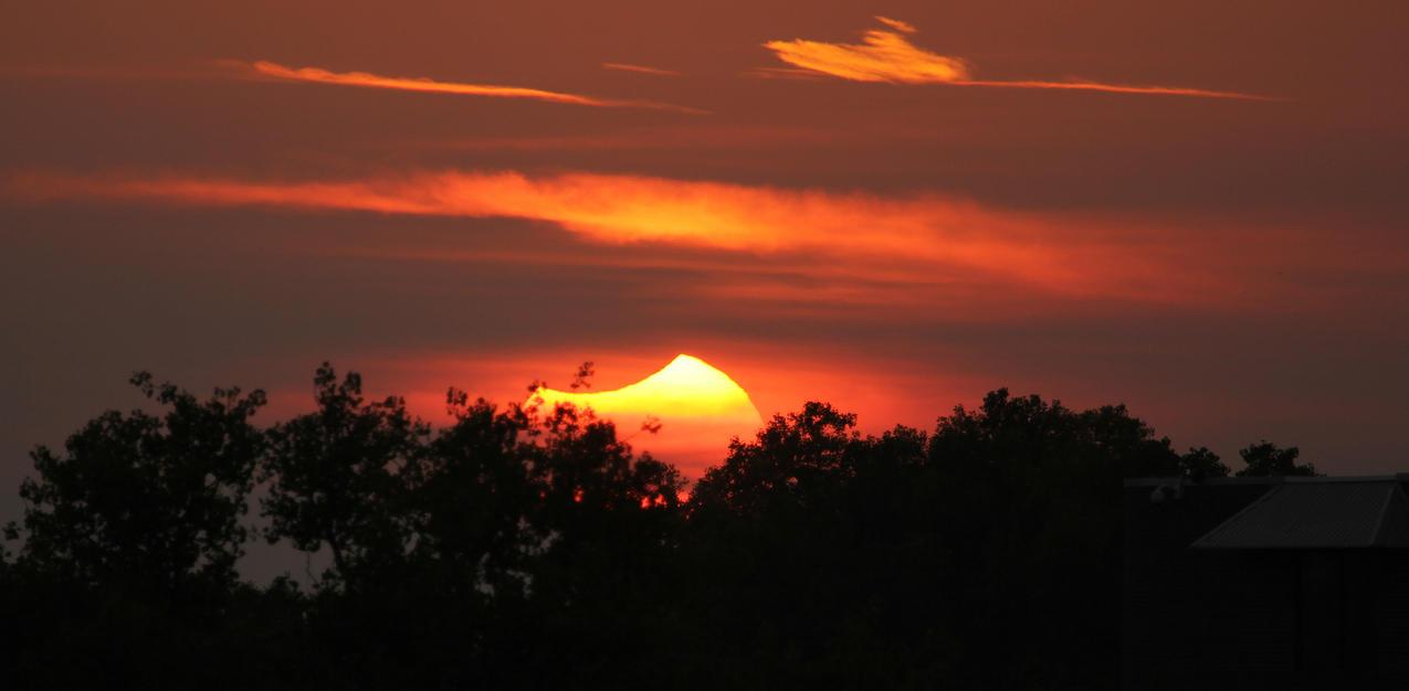 Partial Solar Eclipse Sundown (3 of 3) by Snowleopard59