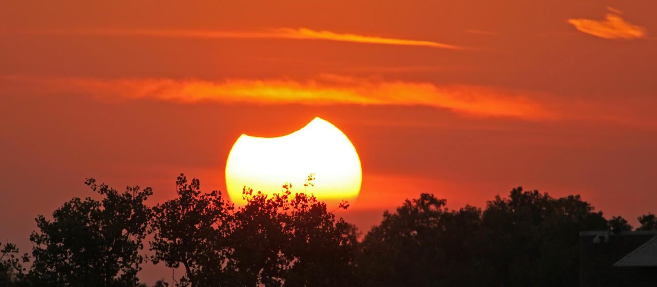 Partial Solar Eclipse Sundown (2 of 3) by Snowleopard59
