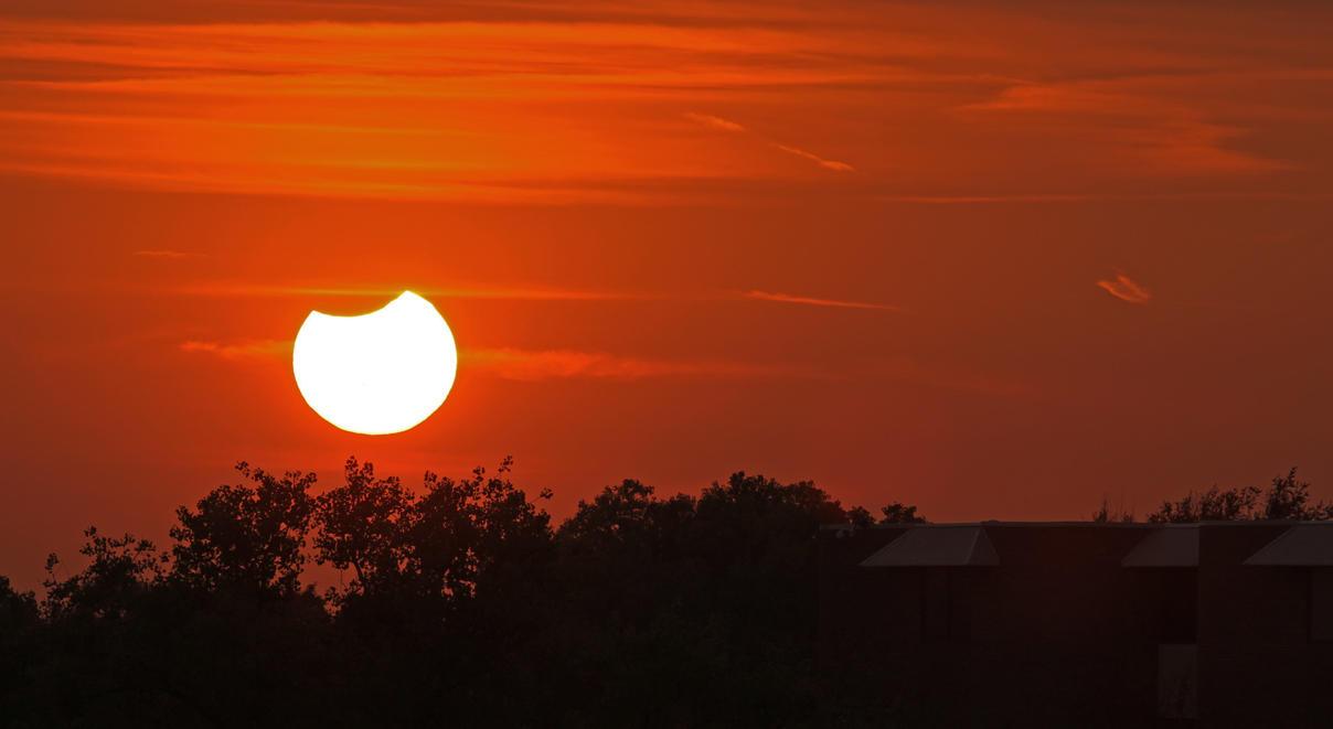 Partial Solar Eclipse Sundown 1 by Snowleopard59