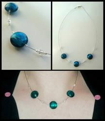 Three Blue Beads