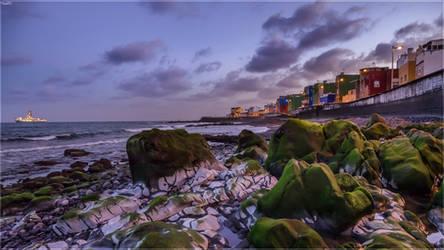 Green rocks after sunset