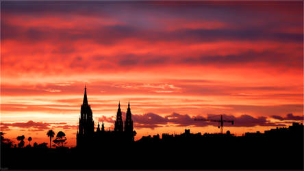 Red skies over Arucas City by Kaslito