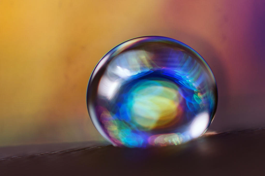 Tiny water droplet with prism effect by bertnijholt