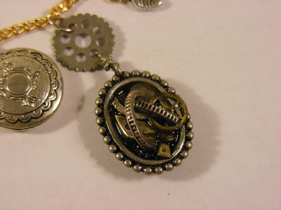 detail from steam punk charm necklace by Mme-Gerhardt