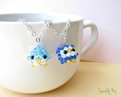 Penguin meets Owl by SparkleMeHappy