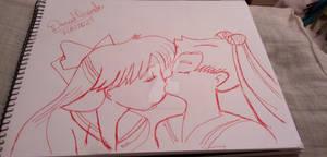 Sailor Venus and Sailor Moon kissing