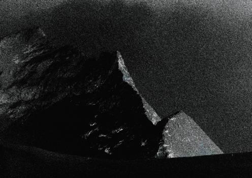 Black snowy mountain