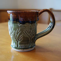 Green, Brown Tree Themed Ceramic Mug by pixelboundstudios