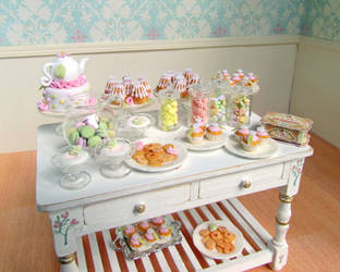 Sweets table by GoddessofChocolate
