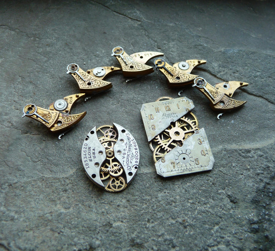 A Flock of Mechanical Birds Plus Other Pendants by AMechanicalMind
