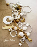 White and gold charm bracelet by janedean