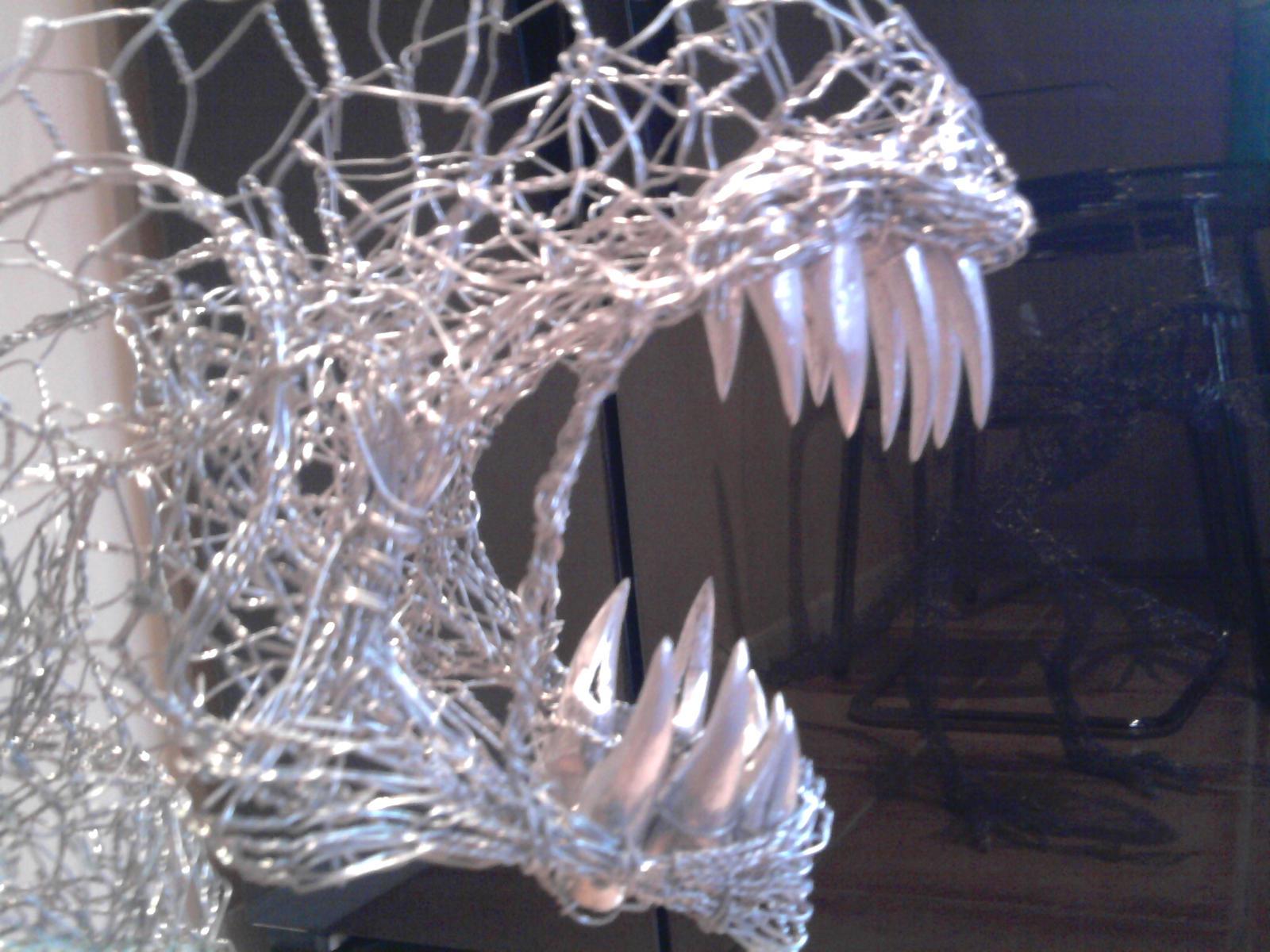 wire alien sculpture closeup by braindeadmystuff