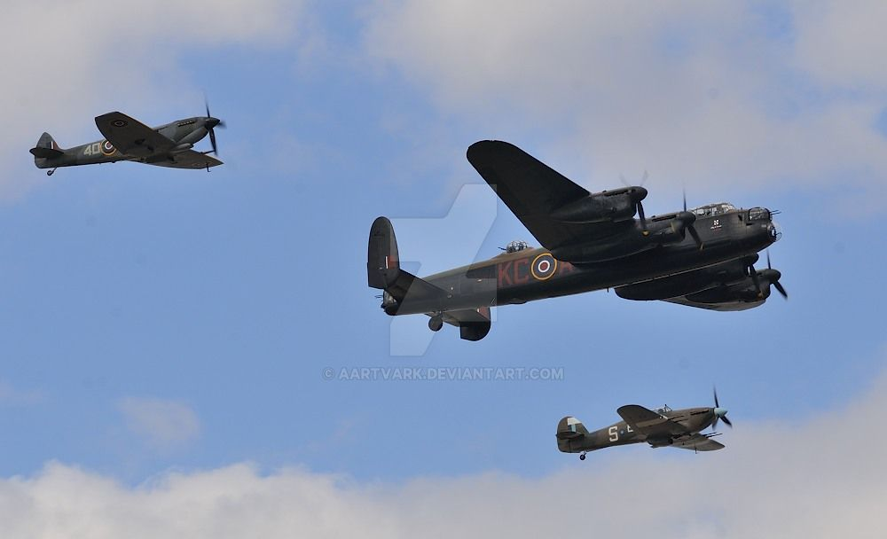 Lancaster Bomber and escort by aartvark