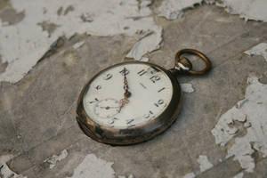 stock old broken pocket watch