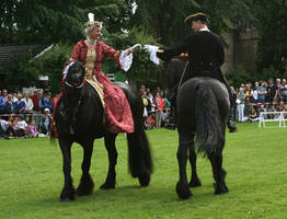 baroque couple on friesian horses
