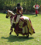Knight red golden on a horse walking away