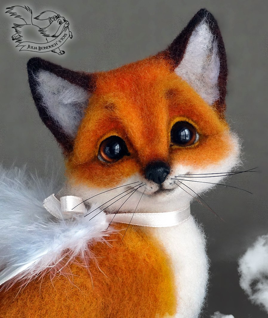 Handmade wool felted foxes