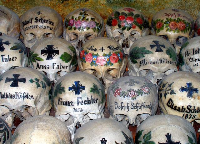 Painted skulls of Hallstatt, Austria by micahgoulart
