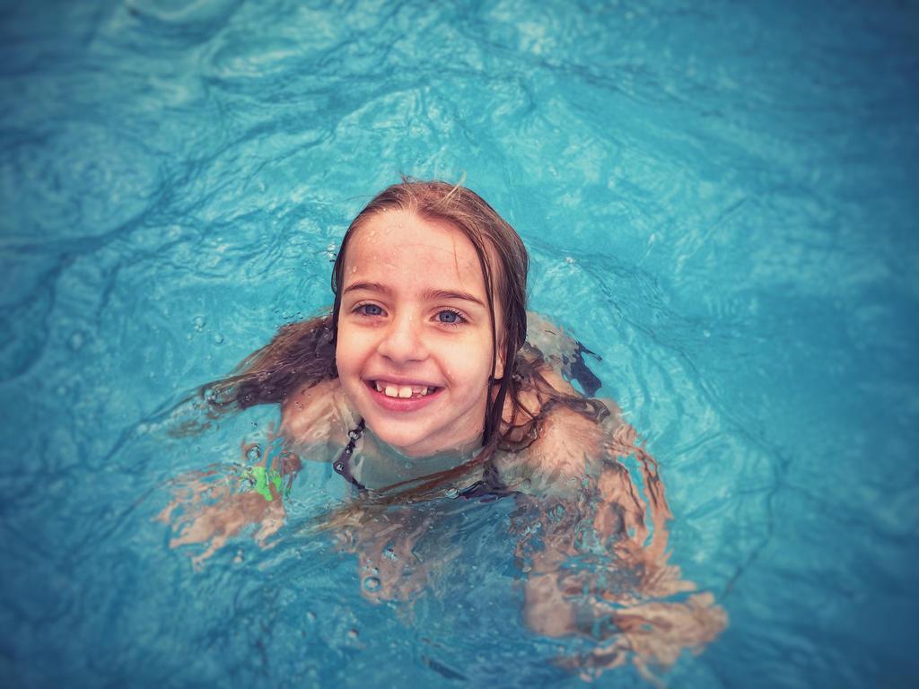 Sofia enjoying hot springs  by micahgoulart