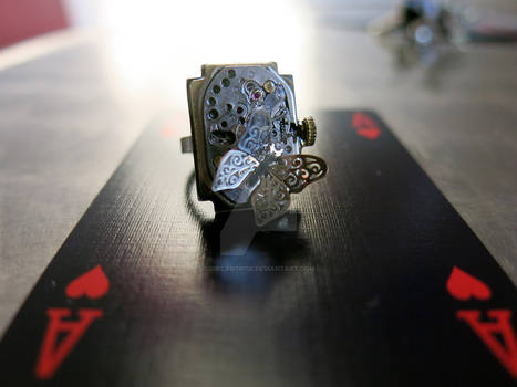 Ring with old mechanism and butterfly. Ref.53