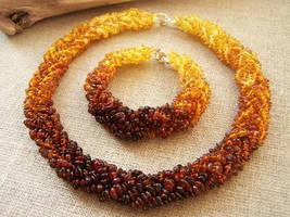 Necklace and bracelet set by MadOnion1