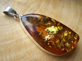 Amber Charm with Flakes by MadOnion1