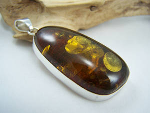 Gold flaked amber pendant