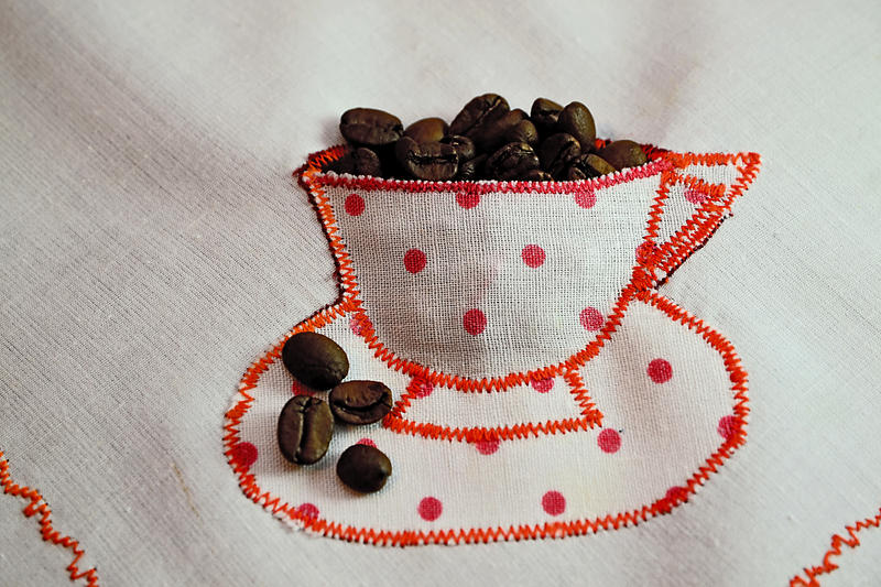 Cup with coffee beans by gabiano