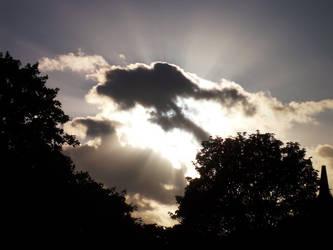 Sun Through Clouds by serialphotographer