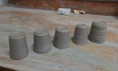 Unfired Small cups by Lunarscarredwolf