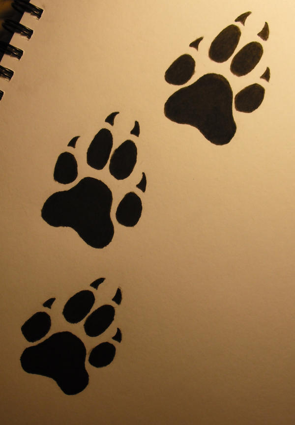 Wolf paw print tattoo by