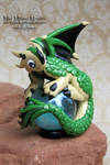 Scaled Green and Tan Polymer Clay Dragon on a Marb