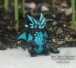 Black and Teal Spotted Dragon Sculpture