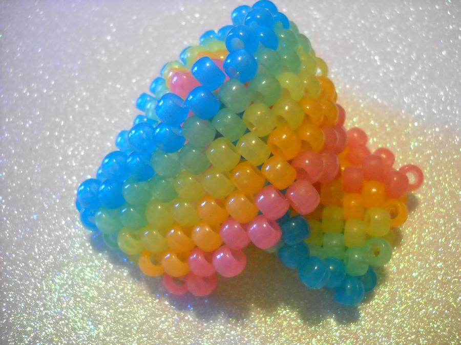 glowing rainbow kandi cuffs by toxiclysweet