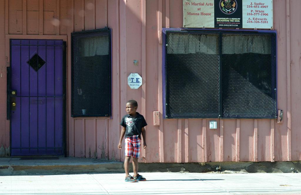 Boy on Cedar Avenue by waitingforlefty
