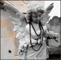 Angel With a Black Mardi Gras Bead by SalemCat
