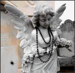Angel With a Black Mardi Gras Bead