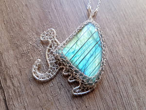 A dragon with labradorite wings :).