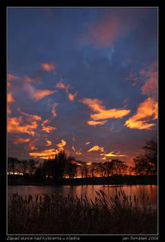 Sunset above pond