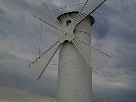 Windmill over sea by shetty05