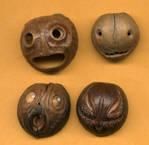 nut hull face pendants