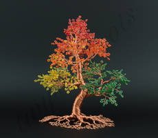 Seasonal multicoloured bead and copper wire tree s by Twystedroots