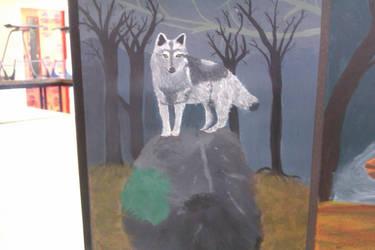 Wolf on a rock by Jozzieblood