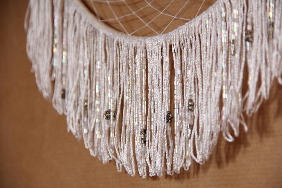 white dreamcatcher with silver stars close up